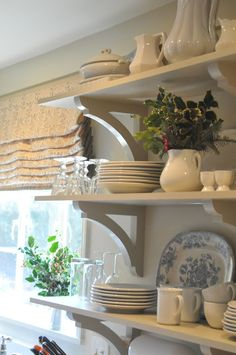Shelving and beautiful texture of the curtains  for our kitchen.