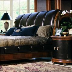 black leather sleigh bed. the bed is perfect although i'd add some more feminine/softer elements for sheets and pillows etc.