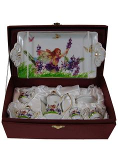 """Nothing could be prettier than our fine quality miniature porcelain tea set scaled just right for use with 18"""" dolls or tea set collections. This porcelain fine china set is created in our Fairy Fantasy pattern and includes a tray, teapot, sugar and creamer set, and 2 cups and saucers. All are attractively stored in a burgundy colored satin lined keepsake box for safe-keeping. Designed and Manufactured by us, The Queen's Treasures"""