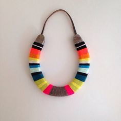 Yarn-Wrapped Horseshoes by Marley and Alfie | Lonny.com