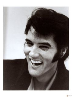 I don't listen to a lot of Elvis, but I adore this photograph of him. Pure joy and laughter.