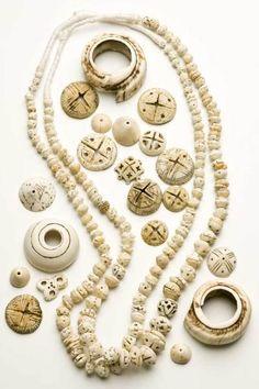 Mauritanian, Conus carved shell.