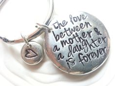 The Love Between A Mother and Daughter is Forever Keychain or Necklace - Personalized, Hand Stamped - Mother's Gift by larkandjuniper on Etsy https://www.etsy.com/listing/155119351/the-love-between-a-mother-and-daughter