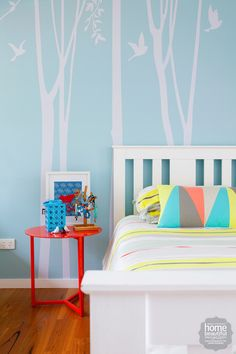 Painted in soft Dulux Airborne, this children's bedroom is a serene space where everything has its own artful place.