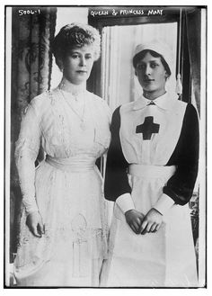 Queen Mary (1867-1953) with her daughter Princess Mary, Princess Royal and Countess of Harewood (1897-1965), who is wearing a Red Cross nurse's uniform