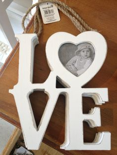 The word love is the most fitting for your special day of the lifetime. Celebrate your wedding with this love hanging photo frame. Hand painted craft.