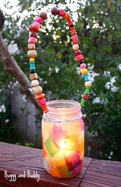 Mason Jar Lantern Craft for Kids: Colorful art project for children using tissue paper, beads, and a candle or LED light! ~ BuggyandBuddy.com