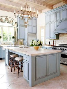 Love the Blue Kitchen Cabinets with light granite counter tops