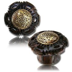 Trend This dark wooden plug is pletely made by hand and features a brass ornament with a