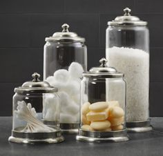 Glass containers, like these Apothecary Jars from Restoration Hardware, will look light and airy in a small bathroom. Featuring a cast-pewter base and lid, their snug-fitting tops will keep contents free of moisture and dust. At Restoration Hardware; $65-$79 each.
