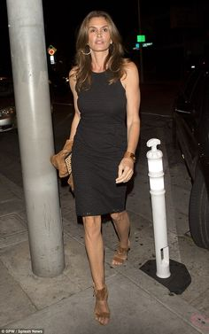 Flawless: The 49-year-old model cut a divine figure in a fitted little black dress as she arrived at Craig's restaurant