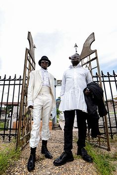 Credit: Junior D. Kannah/AFP/Getty Images Mwetu (left) and Mozar pose as they arrive at the Gombe cemetery in Kinshasa to pay homage to thei...