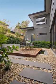 The small deck and decorative gravel add interest and warmth to the small space
