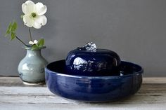 This modern fountain was sculpted with stoneware clay and glazed in deep ocean blue. The piece makes for a stunning modern, understated feature in your home. It is a smaller version of my other fountain as customers have requested it. My cat will only drink from this water. You