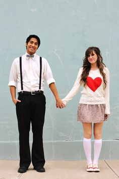 LOVE her outfit! Cute. The red saddle shoes and the heart sweater are on this blog as tutorials too!