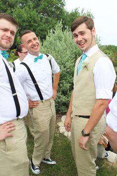 Groom with vest; groomsmen with suspenders