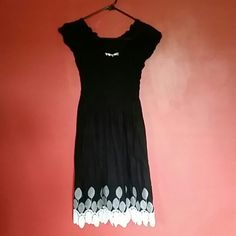 Black Max Studio Dress Simple short sleeve black dress with white detailing at the bottom. The top portion of this dress is ruched with a form fit. Max Studio Dresses