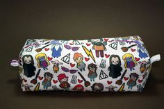 Hey, I found this really awesome Etsy listing at https://www.etsy.com/listing/466199567/boxy-makeup-bag-harry-potter-cast-doodle