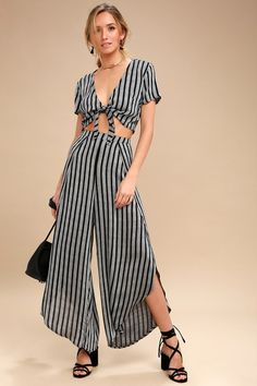 Look out upon the riviera in style in the Grimaud Grey and Black Striped Two-Piece Jumpsuit! A striped two-piece jumpsuit with tie-front crop top.