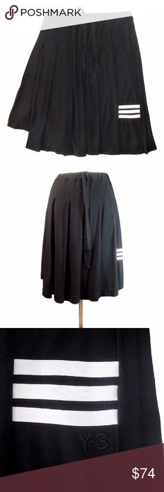 """Y-3 Yohji Yamamoto X Adidas Asymmetric Pleat Skirt Y-3 Yohji Yamamoto Asymmetric Skirt Knee length,  the Y-3 Pleated Skirt slips on with an elastic / drawstring waist. It features sharp pleats with a contrast 3-Stripes Adidas detail and Y-3 embroidery on one side.  Regular fit.  Elastic waist with herringbone tape drawstring.  Size Medium Waist: 28"""" - 33"""" Length: 24"""" Yamamoto's long-running collaboration with Adidas is an antidote to fast fashion's proliferation. """"It's based on a sporty…"""
