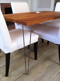Modern industrial/mid century modern style dining table featuring reclaimed sycamore barnwood top with hairpin legs. $745.00, via Etsy.