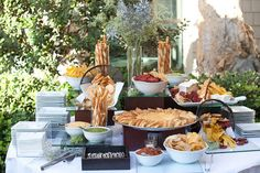 Love Station with rustic bread, twisted cheese straws, sun-dried tomato pesto, brie en croute, homemade vegetable chips with dipping sauces of eggplant caponata, parsley chimichurri, fava bean shallot caviar from our blog, Food Fun and Love: WINTER WEDDING BEACHSIDE