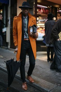um. the orangey brown jacket popping against the black tones is blowing my mind.