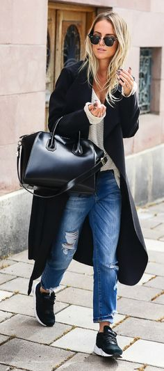 This black maxi coat is simple but effective when paired with distressed denim jeans and black sneakers. Via Kristin Sundberg.  Coat: Ikrush, Knit: Kappahl, Sneakers: Puma.