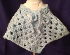 A personal favorite from my Etsy shop https://www.etsy.com/listing/259101539/granny-square-poncho-for-18-doll