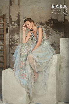 Wedding dress Lofgrein by Rara Avis. Sleeveless A-Line pastel blue floral motive wedding dress. Ship worldwide. Based in Vancouver, Canada.