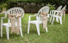 dressed white plastic chairs with burlap detail.