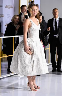 In Christian Dior at the Los Angeles premiere of The Hunger Games: Mockingjay - Part 1.   - ELLE.com