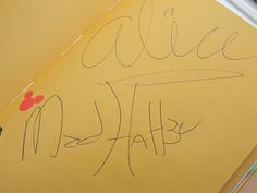 Alice & Mad Hatter's Autographs ~ These look a little different than the ones I've seen from Disney World.