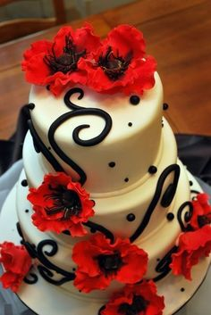 @Stacy Freeman - maybe she can just do simple black designs and then have red flowers on the cake...   Wedding