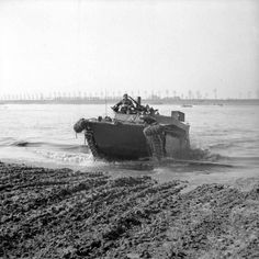 A Buffalo comes ashore on the east bank of the Rhine, 24 March 1945.