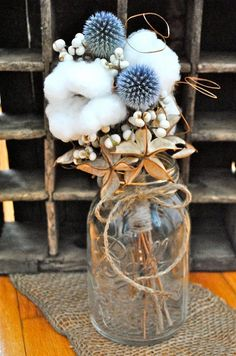 This mini bouquet features natural cotton, cotton burs, beautiful naturally blue globe thistle, tallow berries, and ting branches. Stems are wrapped in twine an it fits nicely in mason jars. Would make cute table decor ~ Tall Cotton n Peas on Etsy