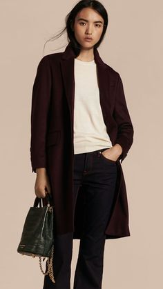 A tailored Burberry coat in soft, lustrous Italian cashmere for your work and weekend wardrobe. A traditional British silhouette with a modern feel inspired by men's tailoring.