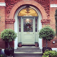 Tom's festive entrance is given a contemporary feel by using Pigeon on the front door. Front Door Planters, Front Door Porch, Wood Front Doors, Front Door Entrance, House Front Door, Painted Front Doors, Glass Front Door, Front Entrances, House Entrance