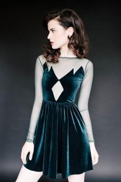 Our Summit Dress is back! This four way stretch velvet and mesh dress with cut out detailing is our best selling item. Available for a limited time in green an