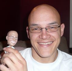 Custom Bobblehead dolls made to look like your photo.  I am so happy to share this with you.  Look how amazing they are!