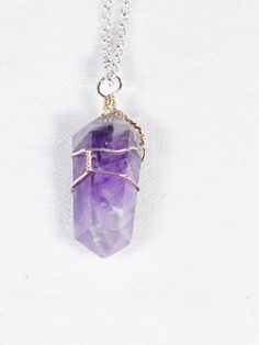 """Treasured today as one of """"Dionysus' Tears!"""" Get it? He drank tons of wine so his tears came out purple. :)  Amethyst Crystal Necklace Double Pointed Handmade Jewelry Hand Wire Wrapped NorthCoastCottage Jewelry Design & Vintage Treasures on Etsy.com, $49.00"""