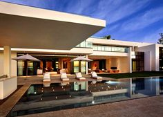"""Completed in 2012 and designed by Miami-based architect Ralph Choeff, this 23,000 square foot (!), two story, nine bedroom, eleven full bathroom and 2 half bath waterfront residence is located in Miami Beach, a coastal resort city in Miami-Dade County, Florida, USA. Described as a once in a life time residence, this property is offered at $38 million. Buy it now! Miami Beach Waterfront Estate overview: """"What Miami dreams are.."""