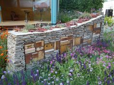 bug hotel built into a garden wall