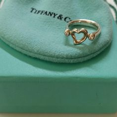 •HP•♡ $sale! Tiffany & Co. Open heart diamond ring Authentic Tiffany & co. Open heart diamond ring. Approxately total 0.8 carats. Comes with pouch and box. Size: 4.5. Tiffany & Co. Jewelry Rings