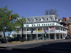 """This is a picture of the Fountainhouse from 2002, after it had been renovated and converted into a Starbucks. It was originally known as William Doyle's Tavern, built around 1752. In the past the inn had also been known as """"Fox Chase"""" and """"Brower's Hotel."""" The inn once had a well in front, but in 1872 the well was changed to a fountain and the name of the tavern was changed to the """"Fountainhouse"""" which is the name it is still known by today. The roof (known as a French Mansard Roof) with the…"""