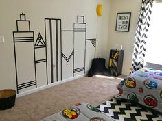 What a great idea! Use tape or paint to make a superhero cityscape!
