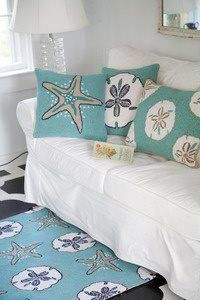 The best decor for any beach house! Sea life pillows, throws, and rugs! How will you decorate your Florida room? www.rmflagstaff.com