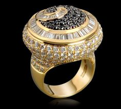 Farah Khan.Black and white diamond ring set in 18k yellow gold.