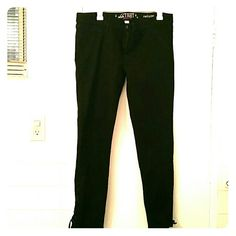 Black jeans with lace up bottoms. Worn once 68% Cotton, 30% Polyester, 2% Spandex. No front pockets but has two back pockets. Can fit someone size 12-14 Jeans Straight Leg