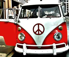 21 window mico bus with pop out front windows in red and white with California style bumpers...oh thats the way to go